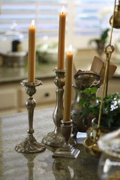 silver candlesticks and beeswax candles in the kitchen