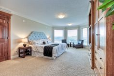 Massive Master bedroom with panoramic views of ravine and pond. Estate Homes, The Hamptons, Pond, Master Bedroom, Furniture, Home Decor, Master Suite, Homemade Home Decor, Water Pond