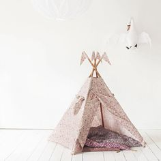 Gorgeous whimsical girls play teepee for nursery or girls room with swan wall decor.
