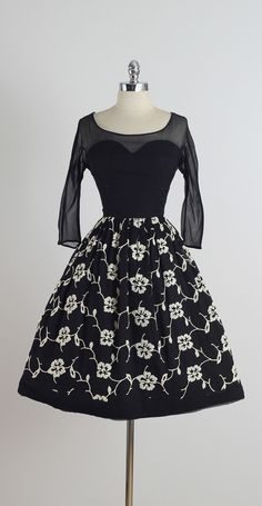 Vintage 1950s Black Embroidered Silk Crepe Illusion Dress | From a collection of rare vintage evening dresses at https://www.1stdibs.com/fashion/clothing/evening-dresses/