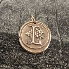 Initial L - modern wax seal letter charm in bronze - monogram jewelry. $33.00, via Etsy.