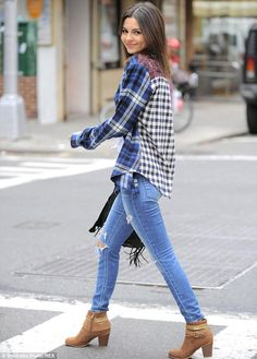Fashionable flare: The button-down top featured a different checked pattern on the front a...