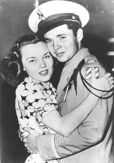Lieutenant Audie Murphy embraces his fiancé and soon-to-be wife, actress Wanda Hendrix, in their engagement announcement photo.