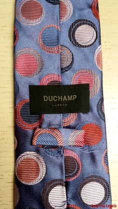 Duchamp Tie Silk Excellent Condition Lilac Pink Red. DESCRIPTION: Genuine Duchamp London Silk Tie  in Excellent condition - no snags/pulls etc.  Really cool funky pattern  Linink is Monogrammed Duchamp   Main Colour:Lilac with pink Purple Red  Material: 100% silk     From Smoke and Pet Free home  Condition of this Duchamp Silk Tie :   Excellent