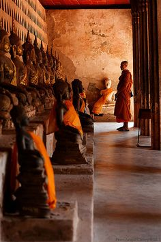 Monks and buddhas at Wat Sisaket, Laos, Vientiane.