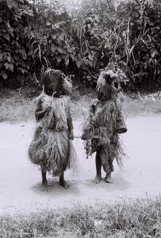 LOXOLOP FACADE: Young Igbo Mask Dancers Wearing Net Masks and Raffia Costumes, photograph by Lorenzo Dow Turner, Nigeria 1951