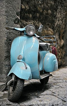 Classic Italian Vespa scooter in the street. I'd really love one of these. Ride it to work.