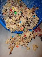 Christmas Crack.  Cap'n Crunch, Chex, Cheerios, Pretzels, Nuts, Candy Bark, M, chocolate chips