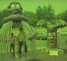 """Jarrett Farrell shares this McMemory with a twist: a three-armed Evil Grimace. While the Bounce & Bend is getting plenty of use, if more for a photo-op, the McDonaldland Apple Pie tree statue has a sign in front that reads """"Please do not climb on the apple tree!"""" This now demolished park was located on Quintard Ave. in Anniston, Alabama."""