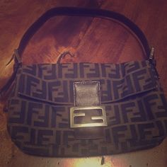 Authentic Fendi Shoulder Bag- Make an offer! 100% Authentic Fendi Shoulder Bag. Zucca. Very durable fabric. Outside is in near perfect condition. Inside does have some makeup stains which I reflected in price. Can be worn during day or at night because size is great! FENDI Bags Shoulder Bags