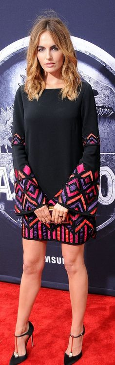 Camilla Belle wearing a sexy and colorful minidress on the red carpet at the Jurassic World premiere
