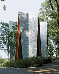 Steeply angled to prevent the accumulation of fallen leaves, the chapel is clad with rough aluminum tiles that deter unsightly sap drippings. Cast in six rectangular shapes, the malleable plates were