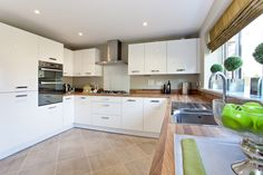 The kitchen in The Oxford at Haversham Gardens in Newport   Bovis Homes