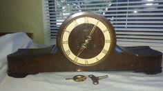 Fleig mantle clock World War II era German made clock. Brass hands and movement. Beautiful key and pendulum.