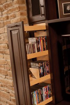 These drawers with an adjustable DVD or CD file system would be perfect for keeping movies organized but out of sight.