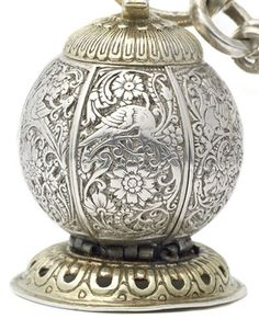 A seventeenth-century pomander and chain, of spherical form on pierced domed foot chased to imitate fluting,  the body divided into six segments released by a screw-down turning finial,  the exterior depicting birds amongst foliage and flowers, each segment engraved at the sides with flowers and foliage
