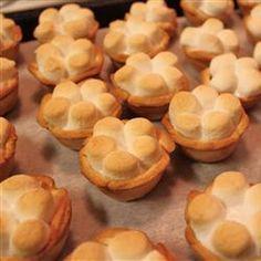 Mini Sweet Potato Pies Recipe Desserts with sweet potatoes, refrigerated piecrusts, evaporated skim milk, egg whites, white sugar, brown sugar, ground cinnamon, ground nutmeg, ground cloves, cranberries