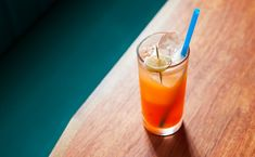 Infernal Collins  1 ounce Maurin Quina  1/2 ounce Campari  1 ounce ginger syrup  1 ounce lime juice  soda water, to top  Garnish: candied ginger
