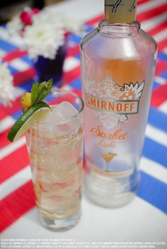 Smirnoff Sorbet Light Mango Passion Fruit and ginger ale drink recipe with 1.5 oz Smirnoff Sorbet Light* Mango Passion Fruit and 3 oz ginger ale. Combine ingredients in an ice-filled glass, garnish with mango slice, lime and fresh mint. #Smirnoff #drink #recipe #SmirnoffSorbet #PassionFruit #memorial #day