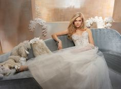 Ivory / Gold Tulle and lace A-line bridal gown. Draped ruched natural waist bodice with a sheer strapless sweetheart neckline adorned with jeweled beading and embroidery. Bridesmaids Dresses & Bridal Gowns by Alvina Valenta - JLM Couture - Bridal Style AV9510 by JLM Couture, Inc.