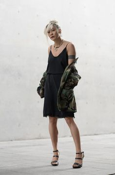 Camo Queen – For a fun evening look, try belting your slip dress for waist definition, & layer on a casual oversized jacket. In this case, the camo jacket plays down the fanciness of the slip dress. It allows for feeling dressed up w/out trying too hard. #slipdress #dress #1item5ways #mix&match #styling #creative #looks #summerfashion #summer #fashion #womensfashion #trend #linen #athleisure #closet #ruicheng #VISIONAIRE