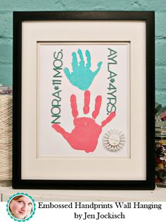 """handprints frame. beautiful. Use embossing ink, colored """"zing' and a heat tool to make the handprints """"pop"""". Add thick stickers for the names and ages."""