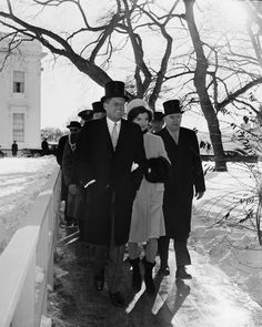 In 1961, President John F. Kennedy and Mrs. Kennedy walk outside the White House during inauguration ceremonies, just as the parade began. An 8-inch snowfall on the eve of Kennedy's inauguration left hundreds of cars marooned and thousands more abandoned. (AP Photo, File)