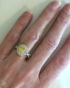 Google Image Result for http://www.myjewelrysource.com/images/yellow-sapphire-ring/gr5727-yellowsapphirering-3.jpg