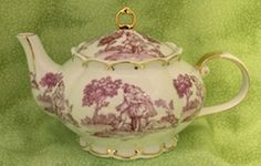 Classic Pink Toile is featured on this beautifully shaped teapot. It is trimmed in 22k gold along the scalloped edges. Toile will stand the test of time in home and kitchen decor and has been a decorator favorite for years.  This is a charming style teapot you will be proud to display! Capacity: 5-6 cups.  Also available in black toile on a white background.  Our customer said: