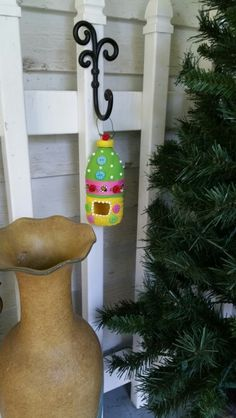 Recycled water bottle bird feeder I made.
