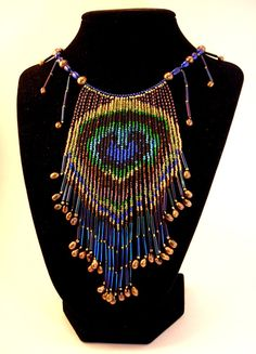 Ransom of Argus - Peacock Feather Bead Fringe Necklace. $100.00, via Etsy.