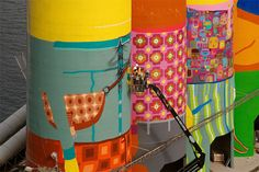 os gemeos colorizes six giant silos on vancouver's granville island - designboom | architecture