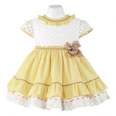 Vestido amarillo y blanco de la marca Miranda. Colección P-Verano