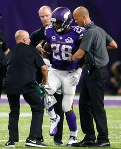 Minnesota Vikings running back Adrian Peterson (28) is helped off the field after getting injured during the second half of an NFL football game against the Green Bay Packers Sunday, Sept. 18, 2016, in Minneapolis. Photo: Jim Mone, AP / Copyright 2016 The Associated Press. All rights reserved.