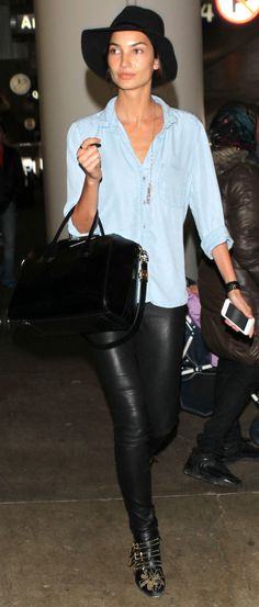 Lily Aldridge's airport style? Leather leggings, chambray shirt, and Chloe Susanna boots