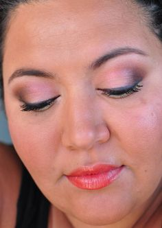 Orange lipstick and smoky brown eyes.