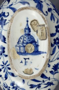 """Florence cathedral appears in miniature on the bottom of an Italian flask along with the letter """"F,"""" the mark of the Medici Porcelain Manufactory."""