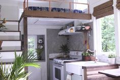 "A pretty little tiny house on wheels, with this open and bright kitchen, and the loft above it, built as part of ""the Handcrafted Movement"" and designed by Matthew Impola."