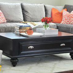 Bright color scheme with grey sofa.
