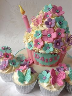 A Giant Cupcake with Mint Green, Purple & Pink Daisies with Butterflies for Daisy... Gorgeous!