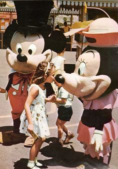 i am really glad disney has better costumes than back then! but, I do have to admit, this is a really sweet photo :)