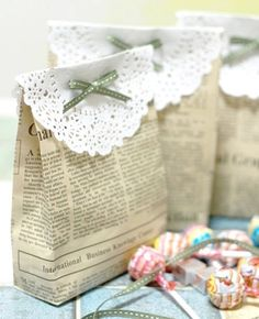 Party favor bags made of newspaper and doilies