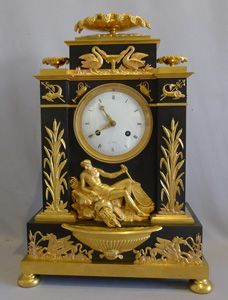 Antique French Empire clock in ormolu and patinated bronze celebrating Poseidon