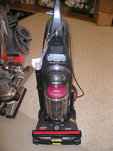 Bissell rewind premier pet upright vacuum: Pet Hair Lifter, Automatic Cord Rewind, Full set of multi-use tools, 5 surface height settings, Bag less, with Easy Empty™ Dirt Cup, and 2 amps of power.