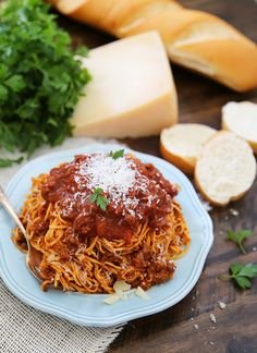 Slow Cooker Spaghetti Bolognese - A rich, classic Italian pasta sauce easily made in your slow cooker! Freeze for later, or dig in with a bowl of warm spaghetti! thecomfortofcooking.com #ad @hollandhousecw