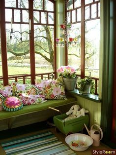 Lovely, romantic pink and green sunroom