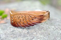 fish leather carving | tooled leather dog collar fashioned to look like a pair of wings