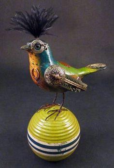 Mullanium - bird - blue/green bird on fancy ball