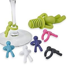 Uniquely designed to provide a creative, fun and entertaining set that will be the talk of any occasion. Drinking Buddy Set includes one avocado colored bottle stopper and six assorted wine charms.