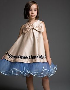 This piece is truly special. It is made from silk, and is embellished with super fine fabric glitter.